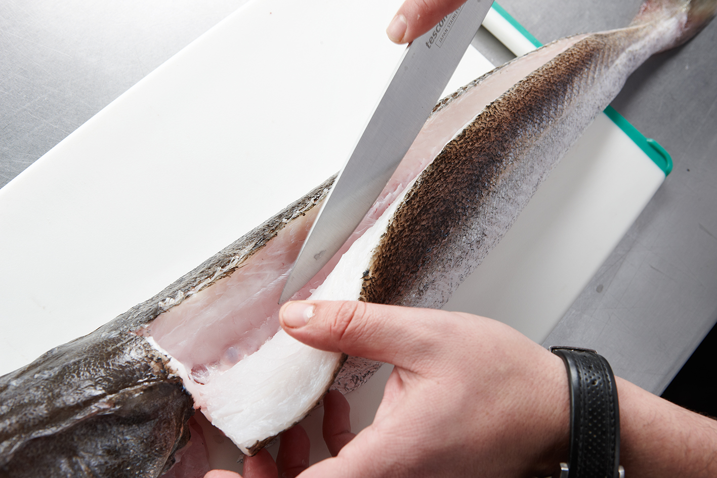 Preparing the hake for a dish by Martin Berasategui Melvin